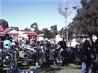 Inverell 2017 Historical village Windmill and restored bikes.jpg